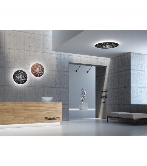 Aplique Lente F46 de pared de 60 cm de diámetro  (negro y óxido) y aplique Lens de techo de 90 cm acabado negro. Fabbian